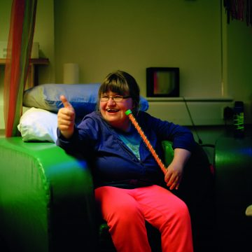 Smiling girl gives a thumbs up